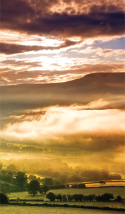 Photo of sunset over mountains in Brecon Beacons National Park, Wales